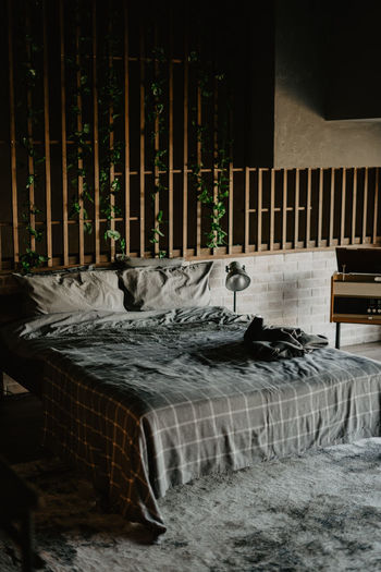 Empty chairs and table in bed
