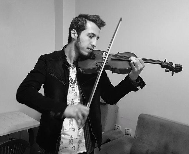 Young man playing violin