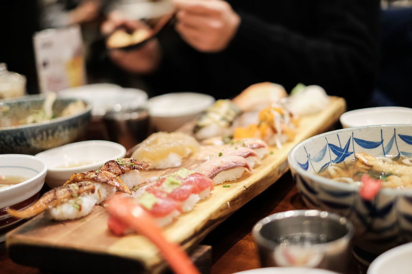 Appetizer Bowl Close-up Day Food Food And Drink Freshness Healthy Eating Human Body Part Human Hand Indoors  Midsection One Person Plate Ready-to-eat Real People Restaurant Seafood Selective Focus Serving Size Table