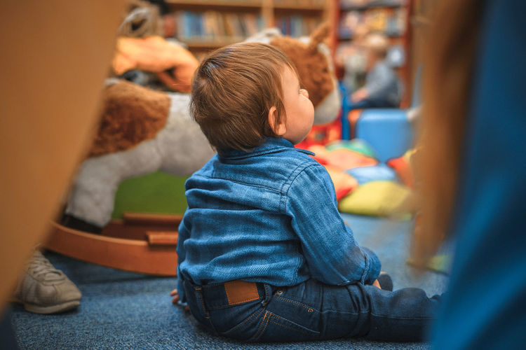 Babyboy Babyhood Boys Casual Clothing Childhood Close-up Day Denim Horse Indoors  Multicolored Playing Real People Rear View Sitting Toy