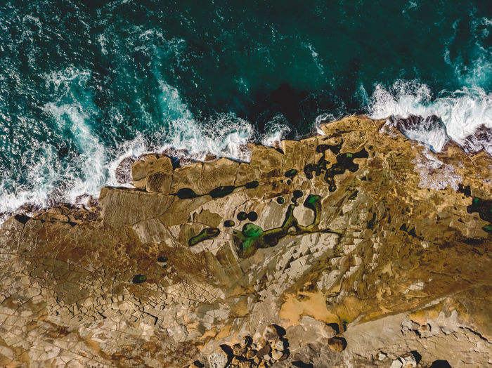 Figure 8 Pool on the Royal National Park coast. Seeing it from above gives a sense of the whole formation and what a surreal place it is. Water Sea Rock Power In Nature Rock Formation Figure 8 Pool Figure Eight Pool Rock Platform Wave Drone  Drone Photography DJI Mavic Air Rock Pool Coastal Feature Coast Australia Royal National Park Pool Water Hole Rock Shelf Figure Eight Pools Figure 8 Pools Hiking Adventures Natural Landmark Natural Pool
