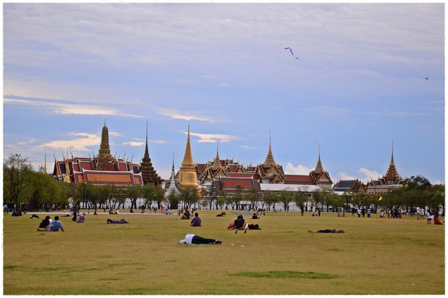 Thailand แดน สบาย Architecture Built Structure City City Life Cloud - Sky Day Field Grass Grassland Green Color Large Group Of People Outdoors Place Of Worship Sky Tourism Tourist Travel Destinations