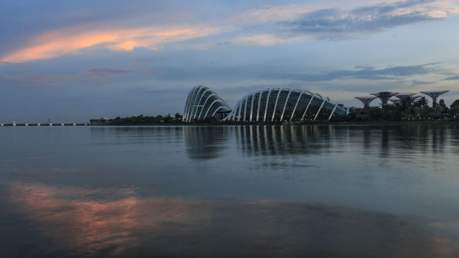 Singapore, Singapore - October 17, 2018: Cityscape view of the Gardens By the Bay including the Flower Dome, Cloud Forest Dome and Supertree grove at sunset Singapore ASIA Gardens By The Bay Orchard Marina Bay Sands Flower Dome Cloud Forest Dome Arab Street Haji Lane, Singapore Modern Art Museum Ocean