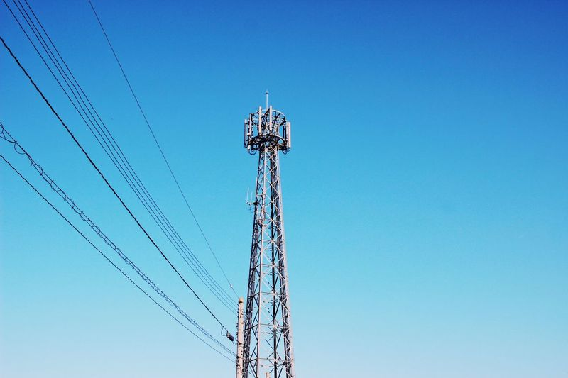 Connection. Sky Low Angle View Blue Clear Sky Tower Tall - High Copy Space Nature Technology No People Communication Connection Day Built Structure Broadcasting Architecture Metal Antenna - Aerial Outdoors Global Communications