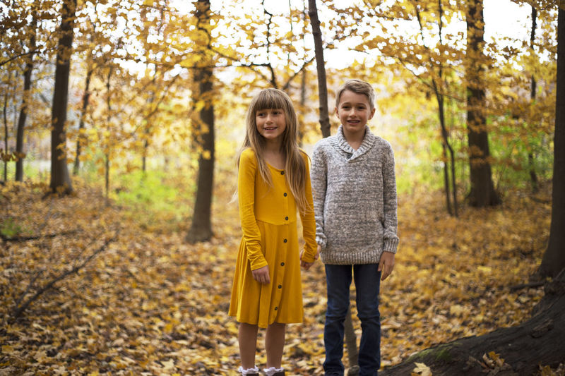 Autumn Togetherness Tree Smiling Looking At Camera Two People Emotion Standing Bonding Nature Child Outdoors Positive Emotion Girls Fall Colors Children Family Siblings