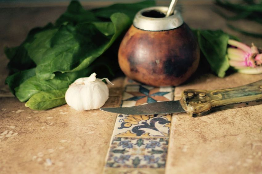 Knife Mediterranean  Ornament Ornamental Yerba Mate Calabaza Close-up Day Elmate Food Food And Drink Freshness Garlic Green Color Healthy Eating Indoors  Ingredient Kitchen Leaf No People Spice Spinach Still Life Table Vegetable