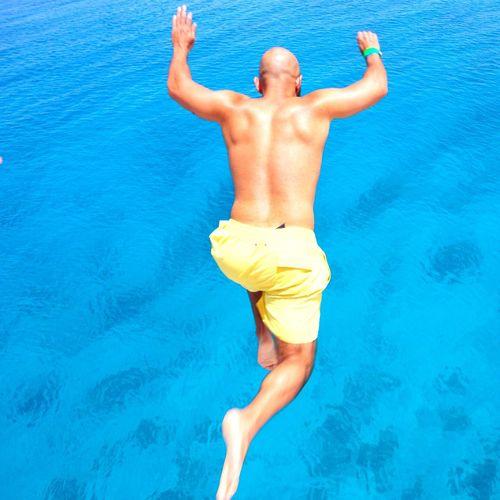 Shirtless Man Jumping In Swimming Pool