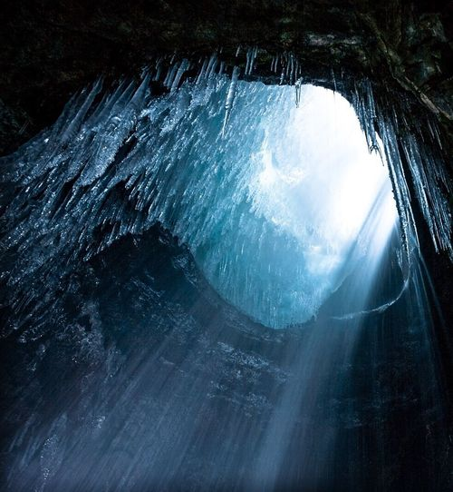 Low angle view of icicle in cave