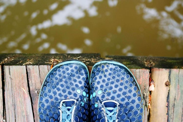 Shoe Part Of Close-up Focus On Foreground Low Section Metal Pair Reflection Pier Person Wooden Blue Extreme Close Up Weathered Day Green Color Wood Planks Creek Vivo