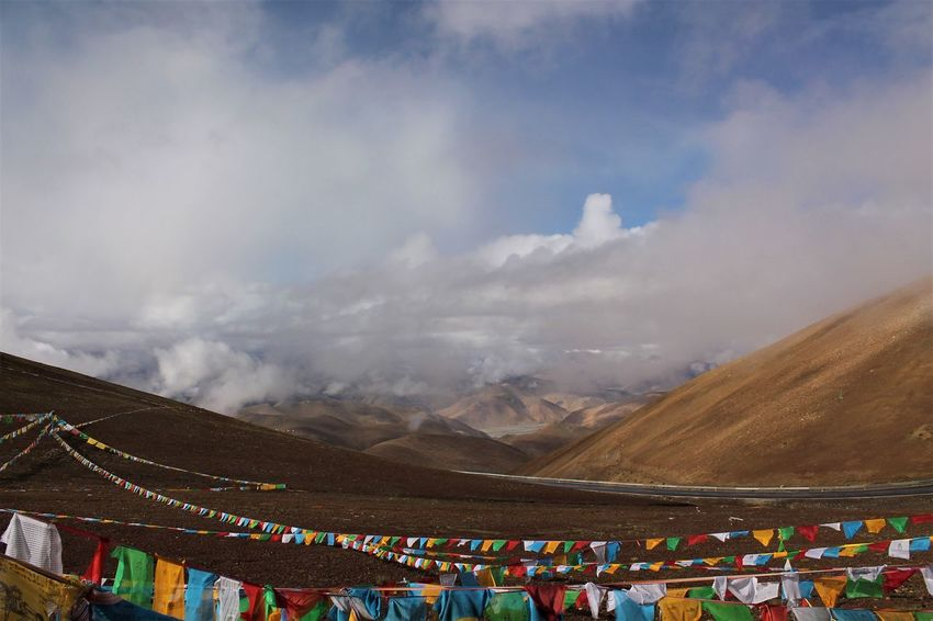 Tibet Travel Beauty In Nature Cloud - Sky Day High Altitude Mountain Multi Colored Nature No People Outdoors Sky Tibet Tibetan Prayer Flags