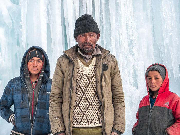 Portrait of friends standing in snow