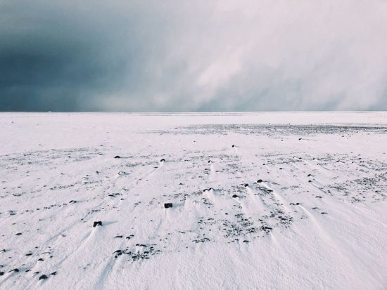 Approaching Storm Iceland Nature Storm Travel Clouds Day Frozen Horizon Landscape Minimalism Nature Outdoors Rocks Sky Snow Tranquility Travel Destinations Vik Weather Wind Winter
