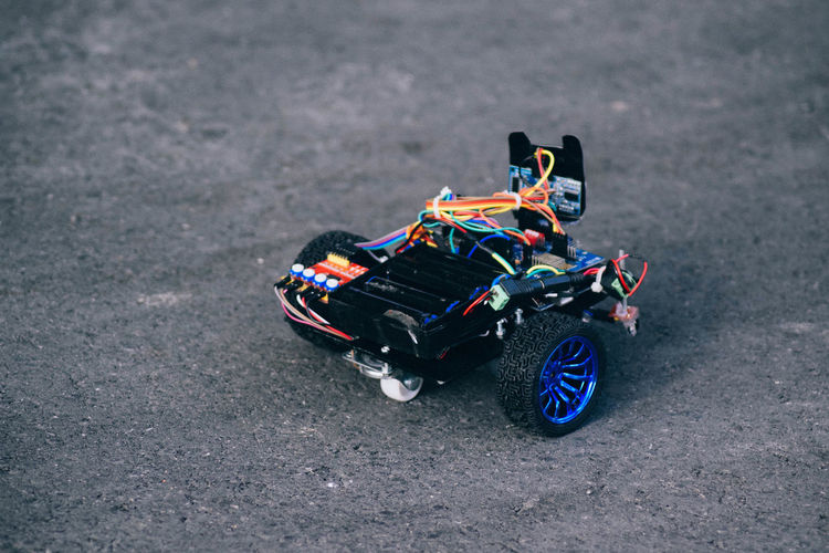 High Angle View Of Toy Car On Road