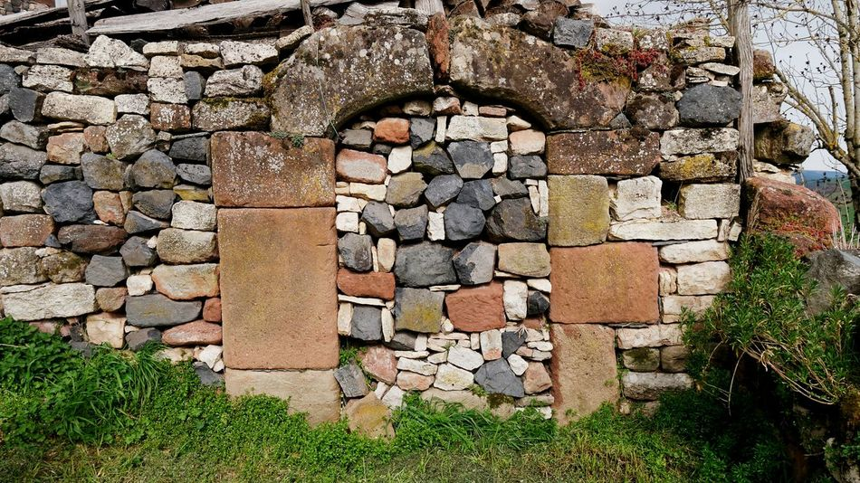 Village de Roquelaure Farm Architecture Architecture_collection Door Stone - Object Stone Wall Basalt Basaltic Rock Colors Multi Colored Arch Aveyron Village Rural Rural Scene Colorful Closed Entry Closed Door Exterior