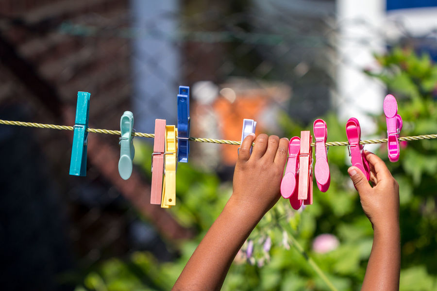 African African American City Clothes Pegs Colourful Afro Caribbean Black British Child Childhood Close-up Colorful Focus On Foreground Garden Human Body Part Human Hand Kid Laundry Pegs Lifestyles Outdoors People Person Of Color Playing Washing Line Young Person The Week On EyeEm