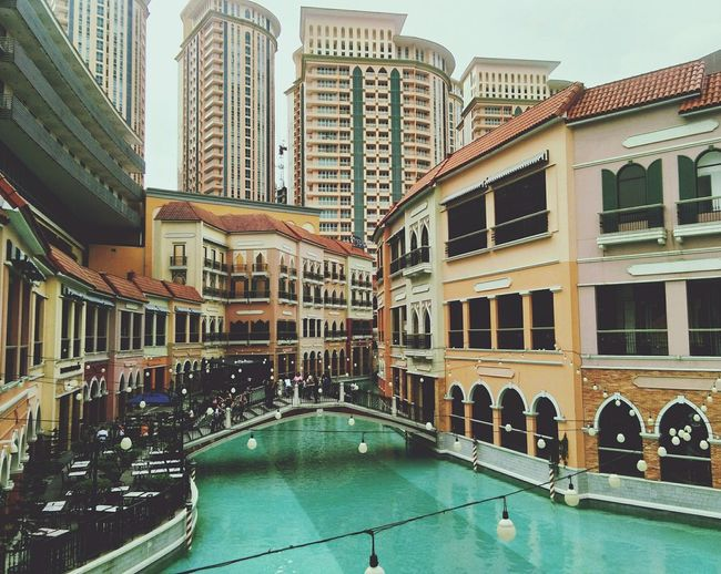 Architecture Travel Destinations Water Tourism Building Exterior Luxury Gondola - Traditional Boat Vacations Skyscraper Built Structure City Outdoors Day Cityscape People Street Life City Streetphotography Street Photography Eyeemphonephotography EyeEm Gallery Eyeem Philippines @eyeemphilippines EyeemPhilippines Mobilephotography Eyeem Philippiness