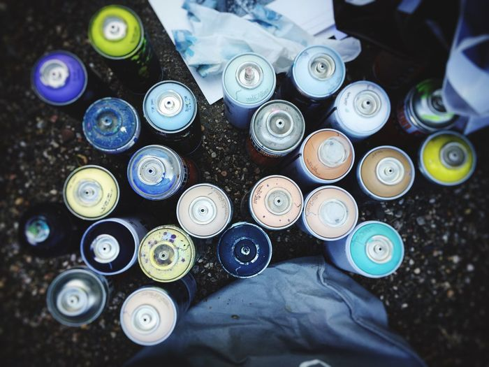 High Angle View Of Spray Cans On Street