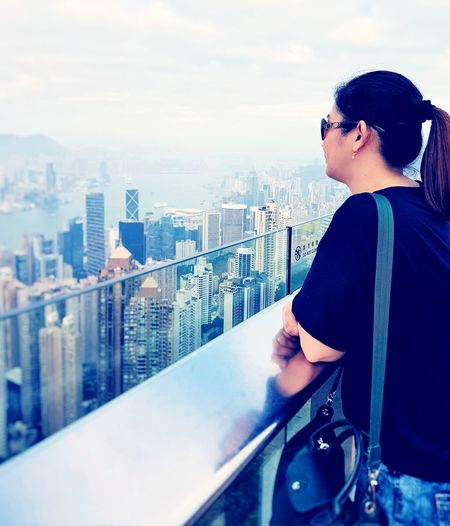 EyeEmNewHere City Skyscraper One Person Adults Only Adult Leisure Activity Day City Life People Cityscape Urban Skyline Outdoors Building Exterior Standing Sky Architecture Mobiography Mobilephotography EyeEm Selects Travel Destinations Thepeak Thepeakhongkong HongKong Breathing Space
