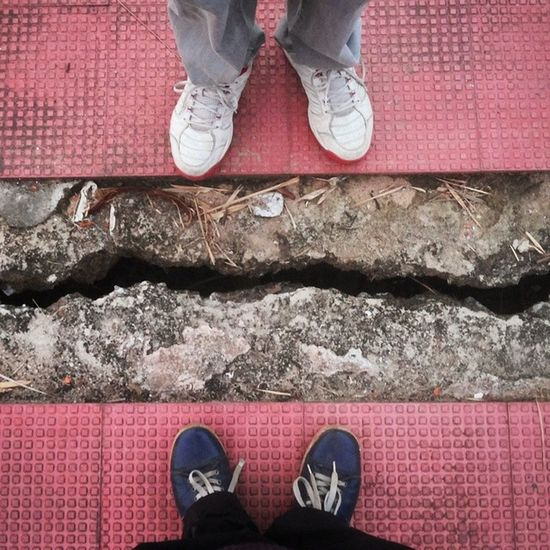 We're world's apart. . Tags : ➡ AtWorldsEnd OnTheEdge Edge crack earthquake shoes worldsapart youandme photospree