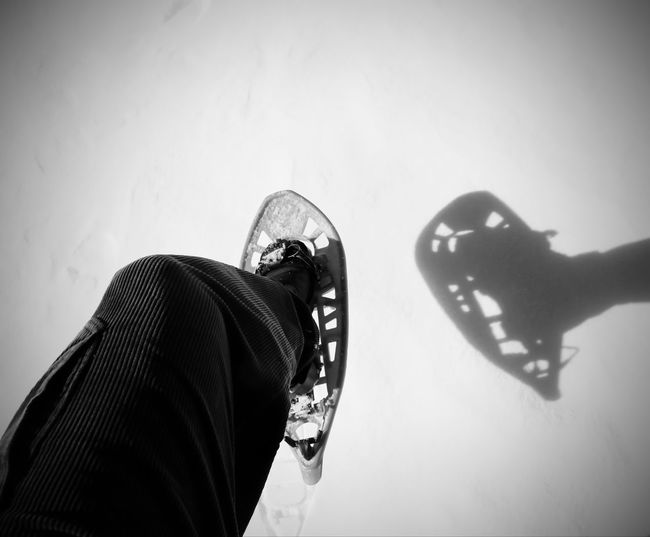 white snow and a snowshoe with shadow in mountain with black and white effect Hiking Snowshoe Winter Wintertime Adventure Cold Cold Temperature Equipment Extreme Sports Hike Mountain People People Walking  Snow Snow Shoeing Snow Shoes Snowshoe Trip Snowshoeing Snowshoes Sport Walking