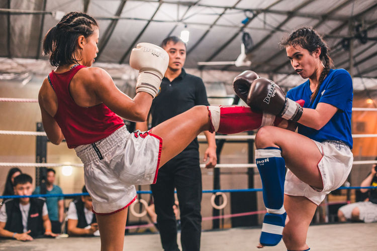 No holds barred. Femalefitness International Women's Day 2019 Sport Real People Competition Boxing - Sport Young Adult Lifestyles People Women Athlete Vitality Effort Woman Young Woman Young Women Sportswoman Muay Thai Fight Kicking