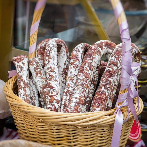 Close-up of sausages in wicker basket at market