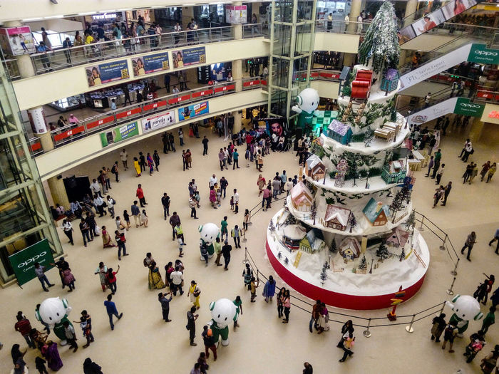 Large Group Of People High Angle View Crowd Shopping Mall Lifestyles Leisure Activity People Indoors  Ice Rink Library Day Adult EyeEm Best Shots The Making Model Of Christmas Man Working Out We R Near To Christmas Christmas Time Christmas Around The World Decorating The Christmas Tree Christmas Decoration People Walking  People Around You Adapted To The City