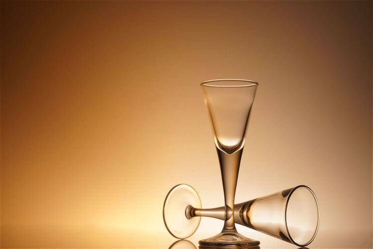 Close-Up Of Martini Glasses Against Colored Background