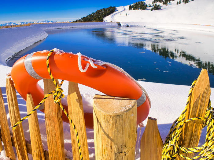 An orange lifesaver of a water reservoir for snow production in the italian dolomites