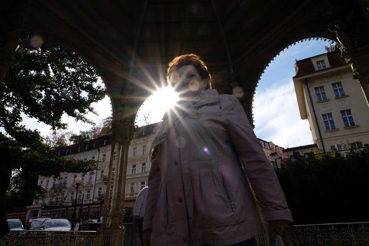 Built Structure Architecture Building Exterior Low Angle View Sunlight Tree Lens Flare Sunbeam Day Sky Nature One Person Building Real People Religion Spirituality Women Belief Standing Sun Outdoors