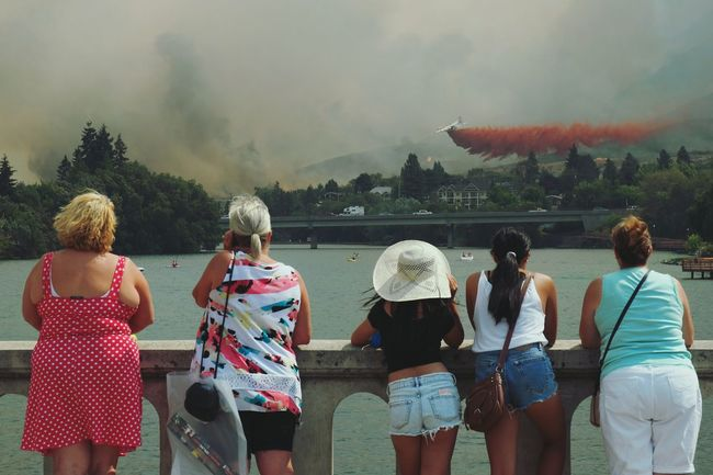 Untold Stories in Chelan. Townies and tourists alike gather to support the Firefighters battling the Firestorm of 2015. People Together Original Experiences Traveling Travel Stories On The Way The Photojournalist - 2016 EyeEm Awards Young Adult Group Onlooker Onlookers Travel Photography Adventures Symbolic  Bridge Outdoors The Changing City Summer Views Wildfire Disaster Natural Disaster Urban Lifestyle Capture The Moment Adapted To The City Connected By Travel Be. Ready.