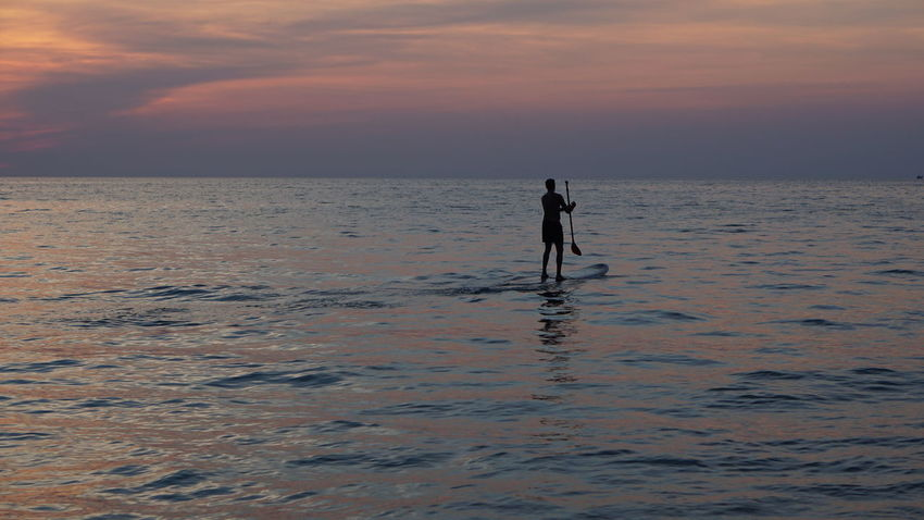 Water Full Length Sunset Sea Paddleboarding Beach Pets Child Dog Silhouette Low Tide Calm Romantic Sky Dramatic Sky Atmospheric Mood Shore Scenics Wave Tranquility Atmosphere