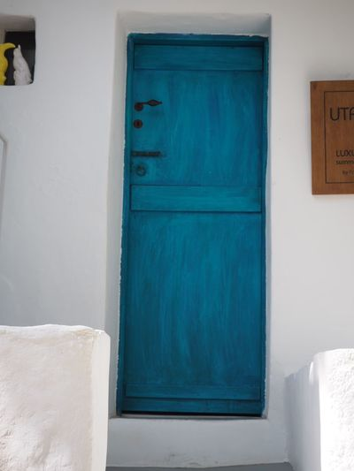 Welcome EyeEm Selects Blue Built Structure Architecture Door Entrance No People Wall - Building Feature Closed Building House Building Exterior White Color Security Protection Turquoise Colored Safety Number Day Outdoors Wood - Material
