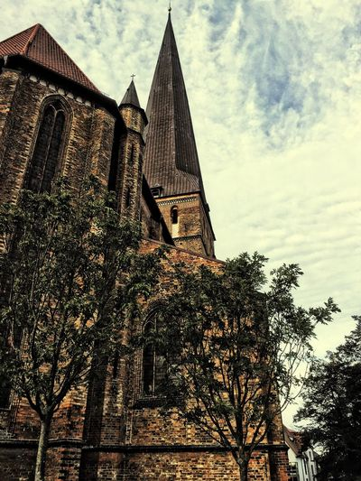 Architecture Building Exterior Church Religion Low Angle View No People Cloud - Sky Rostock Tree Sky