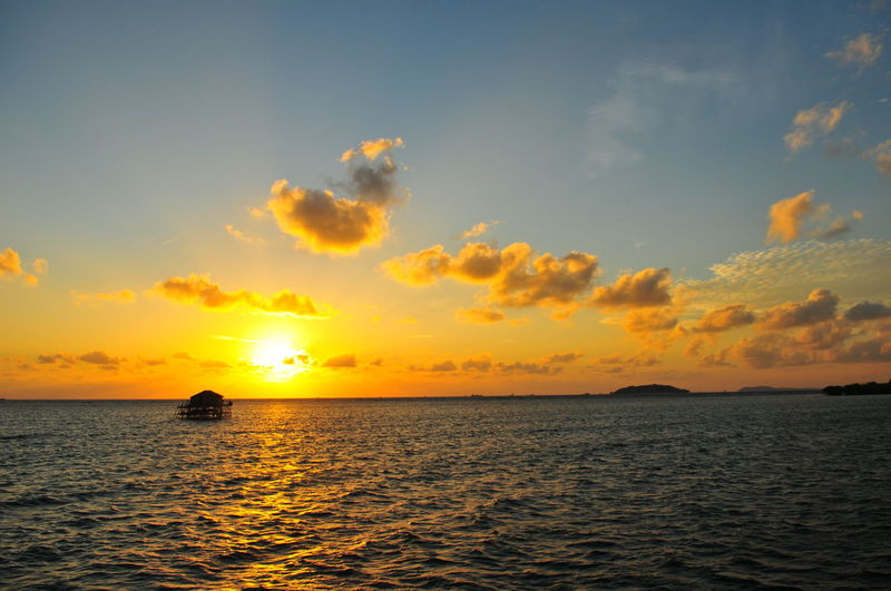 EyeEm Selects EyeEmBestPics Mood Sunlight Orange Silhouette Sunrise Sunrise_sunsets_aroundworld Warm Illustration Water Sea Sunset Beach Nautical Vessel Multi Colored Sun Horizon Summer Sailing Seascape Romantic Sky Island Dramatic Sky Atmospheric Mood Moody Sky Lagoon