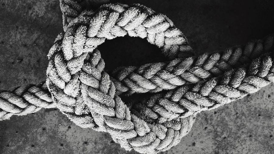 Close-up of tied rope on floor