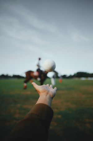 Human Hand Hand Human Body Part One Person Leisure Activity Nature Personal Perspective Real People Ball Body Part Sky Focus On Foreground Finger Land Day Grass Human Finger Holding Plant Outdoors