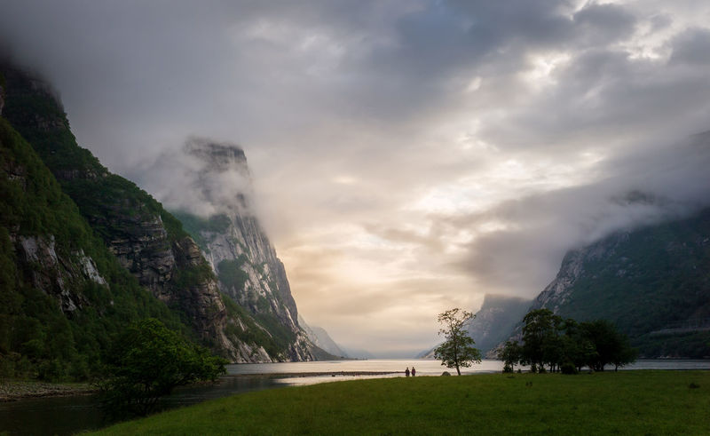 Two women lookin out a fjord in Norway. Kjerag Lysebotn Fjord Norway Evening After Rain Bright Future Optimistic Fjordsofnorway Cloud - Sky Mountain Scenics - Nature Beauty In Nature Nature Tranquil Scene Environment Two People Landscape Outdoors Tranquility Non-urban Scene