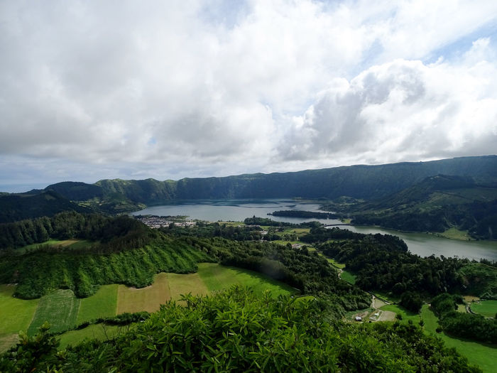 Beauty In Nature Azores Tranquility Tree Water Rural Scene Agriculture Sea Field Hill Sky Landscape Dramatic Sky