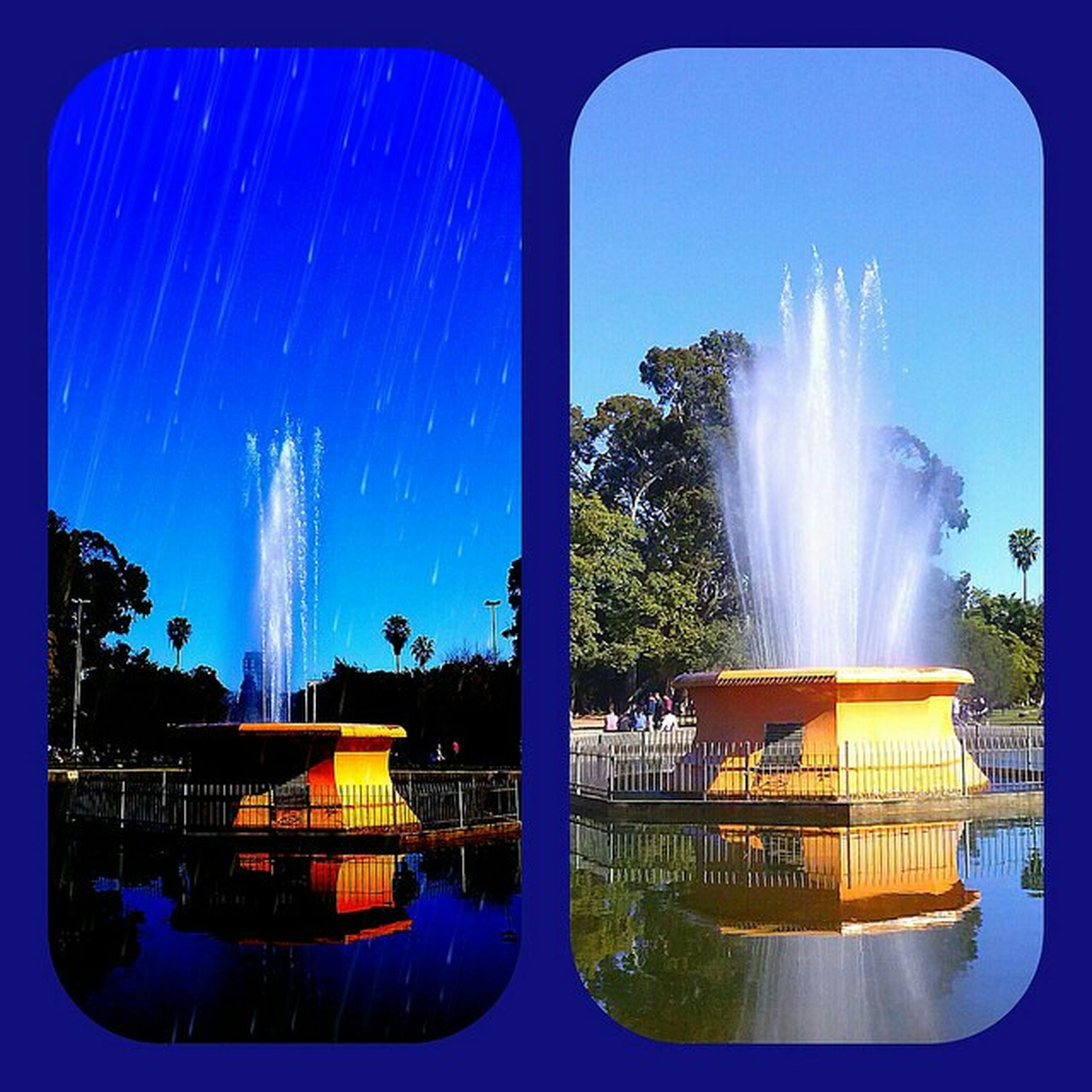 transfer print, water, fountain, blue, auto post production filter, spraying, built structure, sky, architecture, building exterior, motion, tree, panoramic, reflection, swimming pool, waterfront, sunbeam, sunlight, nature, splashing