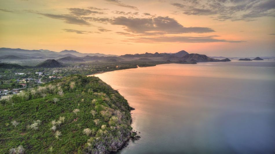 Labuan Bajo, Flores, Indonesia INDONESIA Travel Destinations Labuan Bajo Sky Water Flores Mountain Cloud - Sky Scenics - Nature Beauty In Nature Tranquility Sunset Tranquil Scene Nature No People Mountain Range Environment Plant Bay Outdoors Land Sunrise Sea Tree Idyllic Architecture