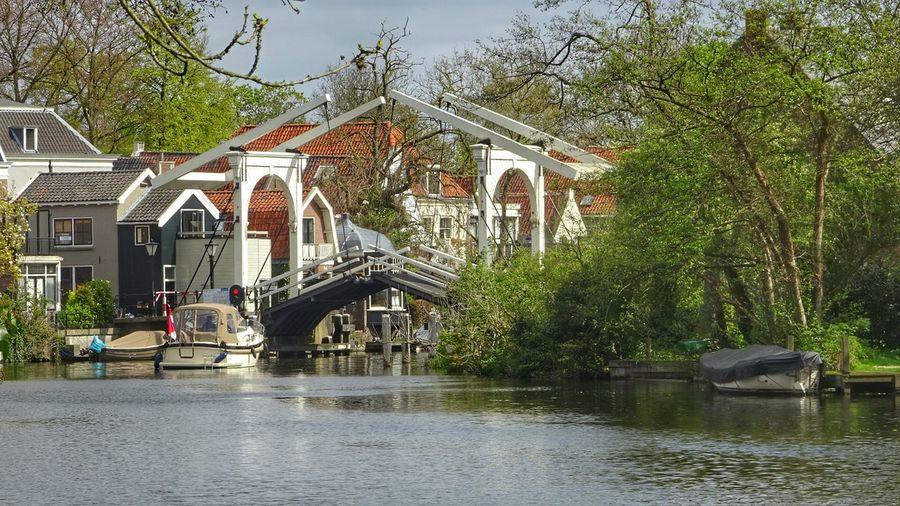 Boat by drawbridge over river vecht