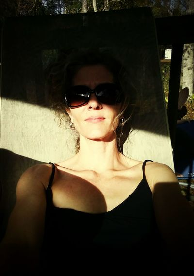 Rachel's Ray Amber Light One Person Adult Portrait Women Who Inspire You Women Of EyeEm Woman Women Sunglasses People First Eyeem Photo Sunkissed Outdoors Winter In Florida Sunbathing Lieblingsteil The City Light Women Around The World