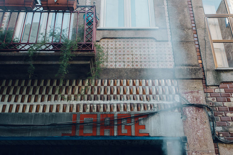 Tilt image of building seen through window