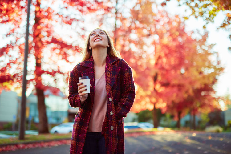 Adult Autumn Beautiful Woman Beauty In Nature Casual Clothing Day Focus On Foreground Front View Leaf Leisure Activity Lifestyles Nature Outdoors Park - Man Made Space People Real People Standing Togetherness Tree Two People Young Adult Young Women