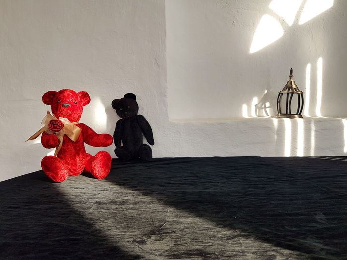 Stuffed toy on table against wall at home