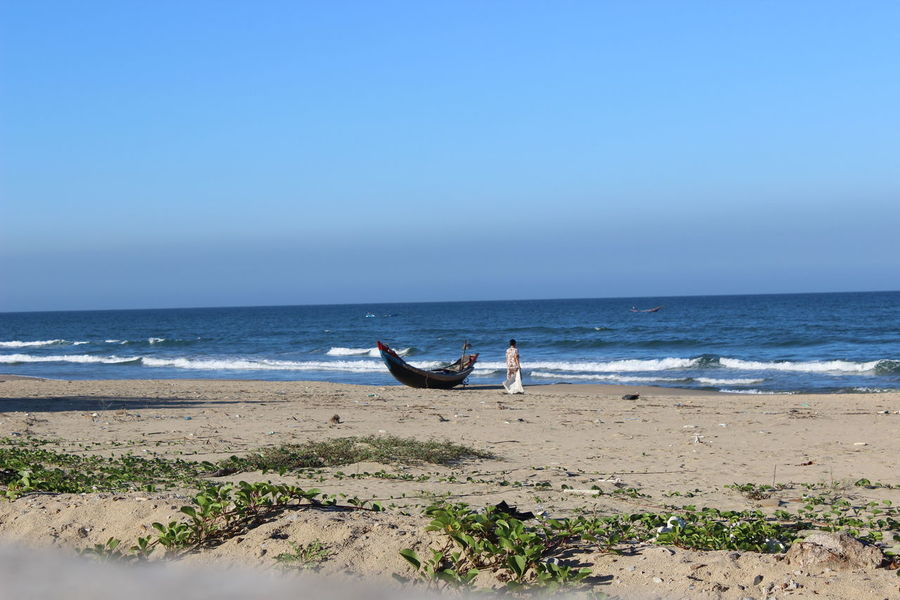 Woman alone on beach Beach Beauty In Nature Blue Boat Calm Coastline Day Horizon Over Water Idyllic Lang Co Beach Lăng Cô Nature No People Non-urban Scene Outdoors Remote Scenics Sea Seascape Shore Sky Tranquil Scene Tranquility Water Woman