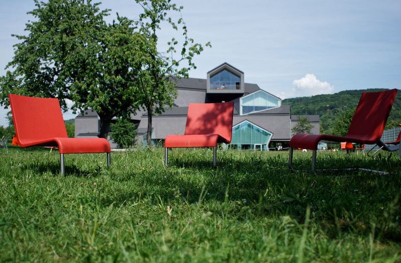 Architecture Vitra Design Museum Absence Architecture Building Exterior Built Structure Chair Day Field Grass Green Color Growth Land Nature No People Outdoors Plant Red Seat Sky Sunlight Swimming Pool Tree Vitra Campus The Architect - 2018 EyeEm Awards