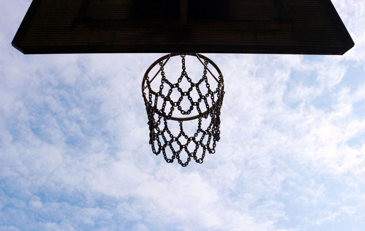 basketball hoop against blue and white sky Ambition. Dedication. Success. Copy Space Silhouette Target Achieve Goals Background Basketball - Sport Basketball Hoop Blue Circle Close-up Competition On Food Day Geometric Shape Goal Low Angle View Metal Nature Net - Sports Equipment No People Outdoors Pattern Sky Sport Sunset