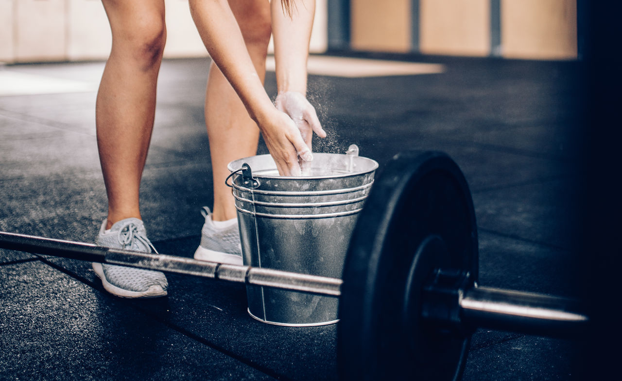 Low section of woman preparing for deadlifts